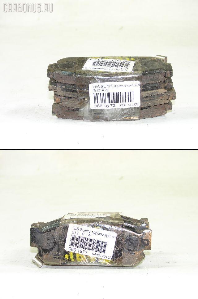 Тормозные колодки на Nissan Sunny B12 Фото 1