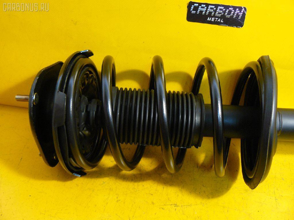Стойка амортизатора TOYOTA COROLLA AE100 5A-FE. Фото 1