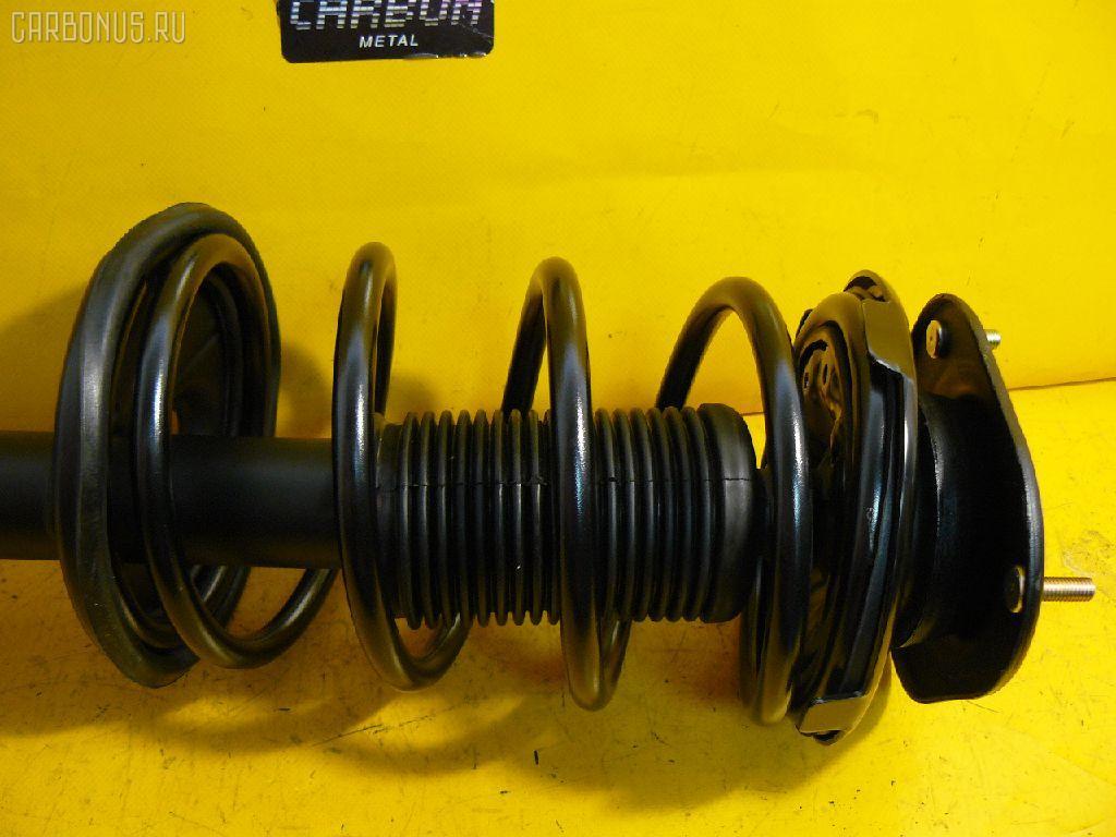 Стойка амортизатора TOYOTA COROLLA AE100 5A-FE. Фото 3