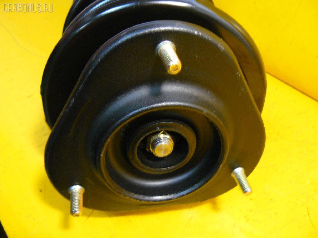 Стойка амортизатора TOYOTA COROLLA AE100 5A-FE. Фото 4