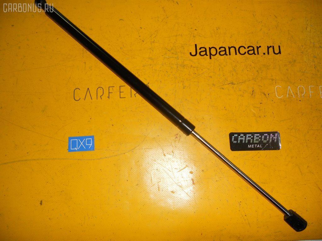Амортизатор двери NISSAN TERRANO LR50 Фото 1