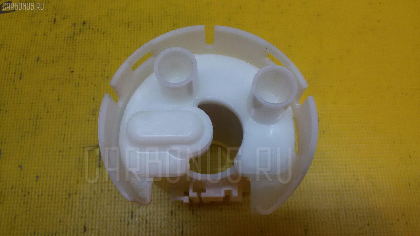 Фильтр топливный Toyota Vitz SCP10 1SZ-FE Фото 1