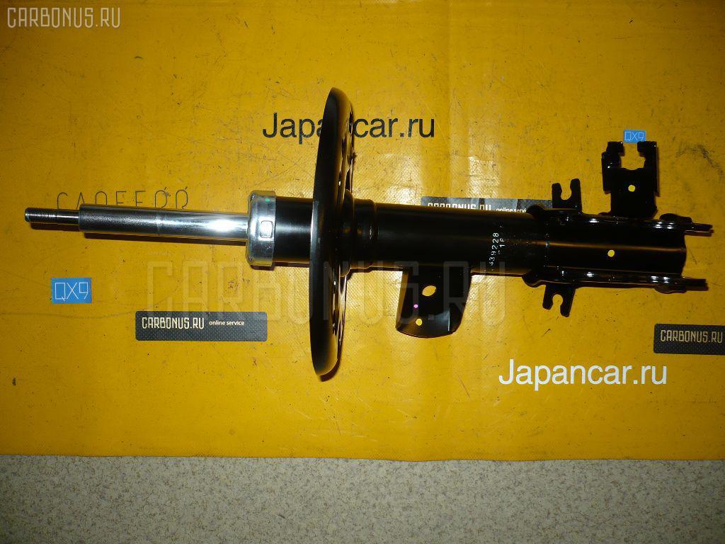 Стойка амортизатора Nissan Teana J32 Фото 1