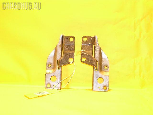 Крепление капота 65400WD000, 65401WD000 на Nissan Wingroad WFY11 Фото 1