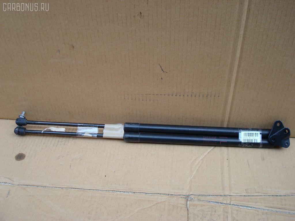 Амортизатор двери NISSAN PRESAGE U30. Фото 1