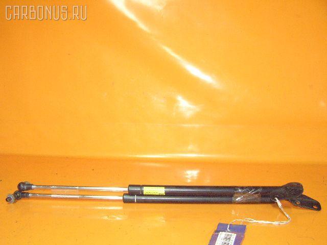 Амортизатор двери DAIHATSU YRV M211G