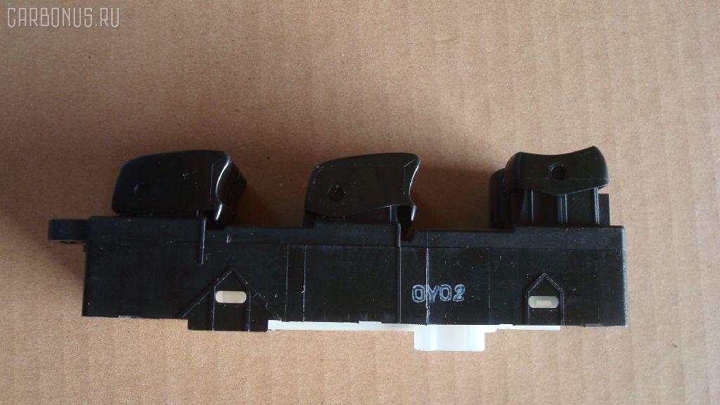 Блок упр-я стеклоподъемниками NISSAN X-TRAIL NT30. Фото 1