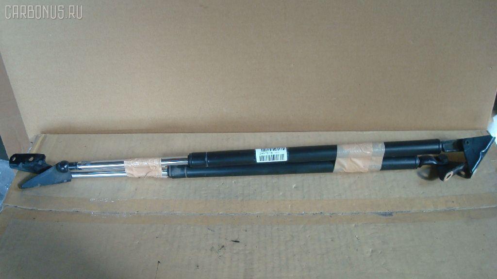 Амортизатор двери TOYOTA IPSUM SXM10G. Фото 2