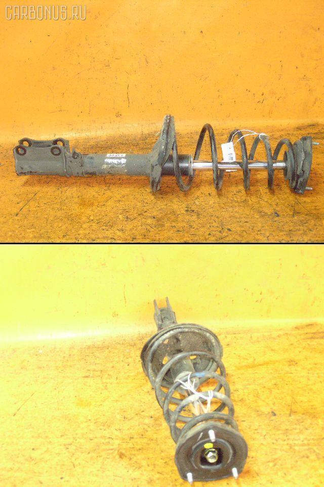 Стойка амортизатора TOYOTA MARK II QUALIS SXV20W 5S-FE. Фото 1