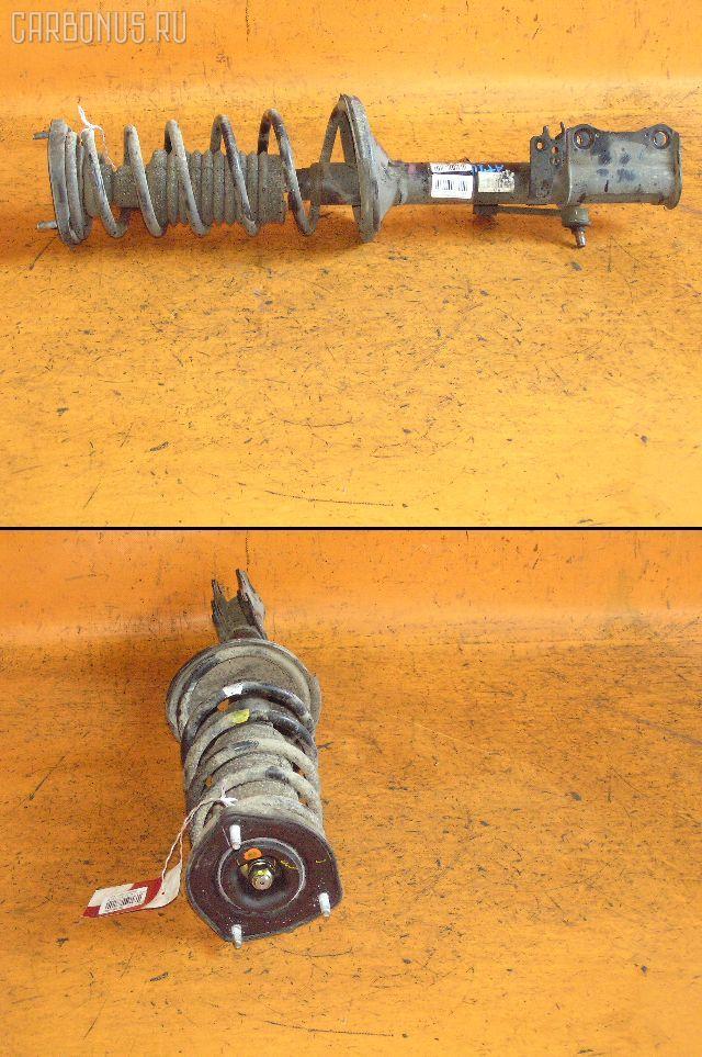 Стойка амортизатора TOYOTA CARINA AT211 7A-FE. Фото 2