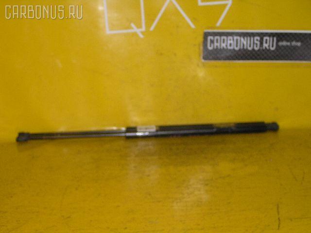 Амортизатор двери PEUGEOT 206 SW 2KNFU Фото 1