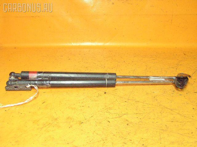 Амортизатор двери TOYOTA CALDINA ST215G. Фото 1