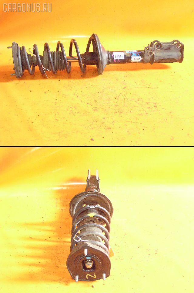 Стойка амортизатора TOYOTA CARINA AT210 4A-FE. Фото 6