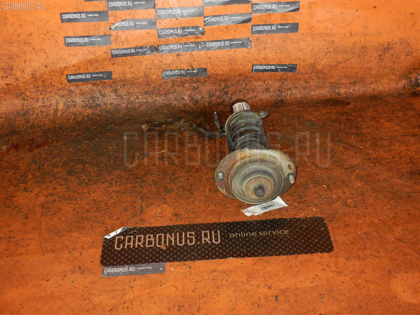 Стойка амортизатора Subaru Dias wagon TW1 EN07 Фото 1