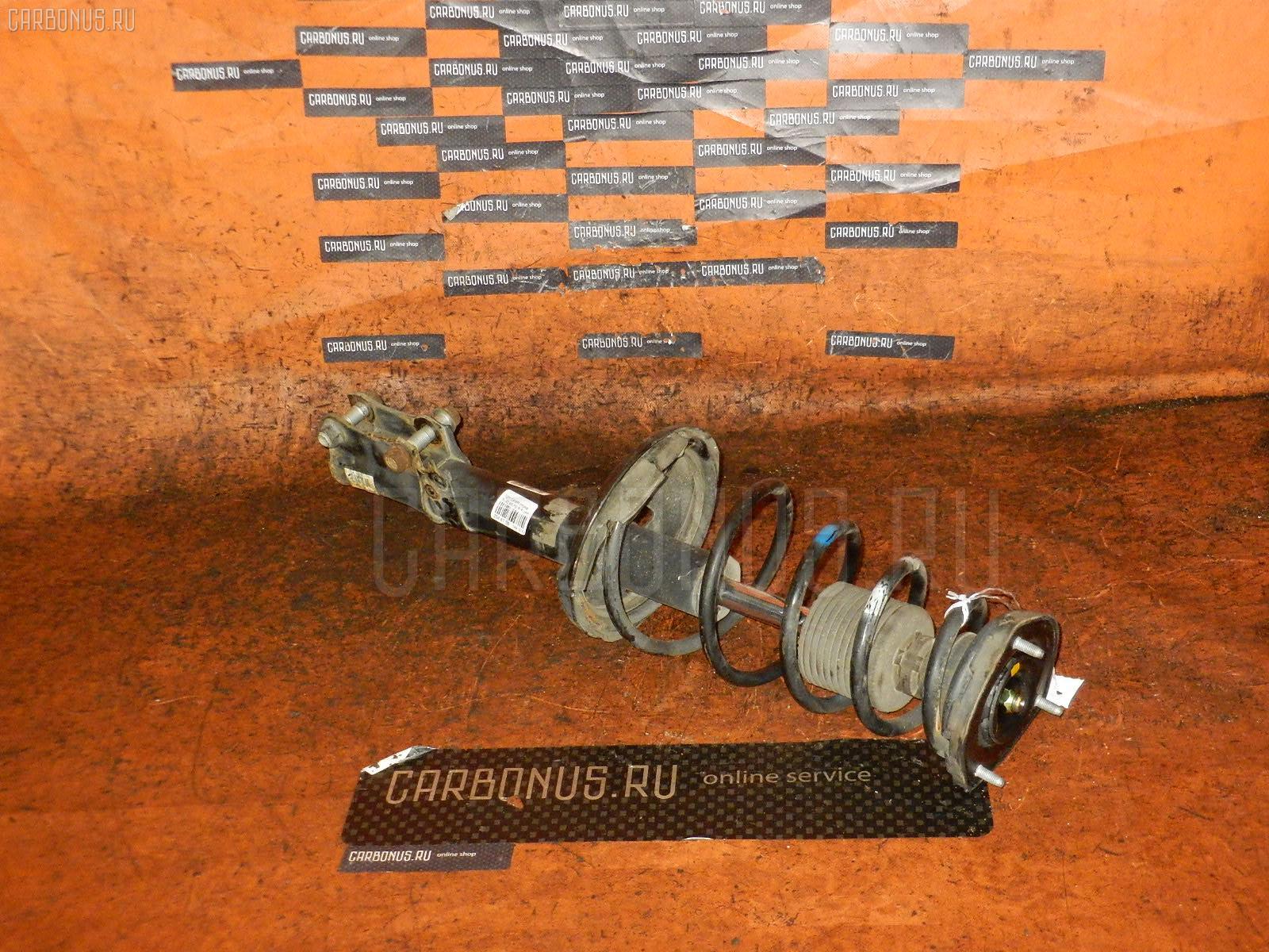 Стойка амортизатора TOYOTA MARK II QUALIS SXV20W 5S-FE. Фото 9