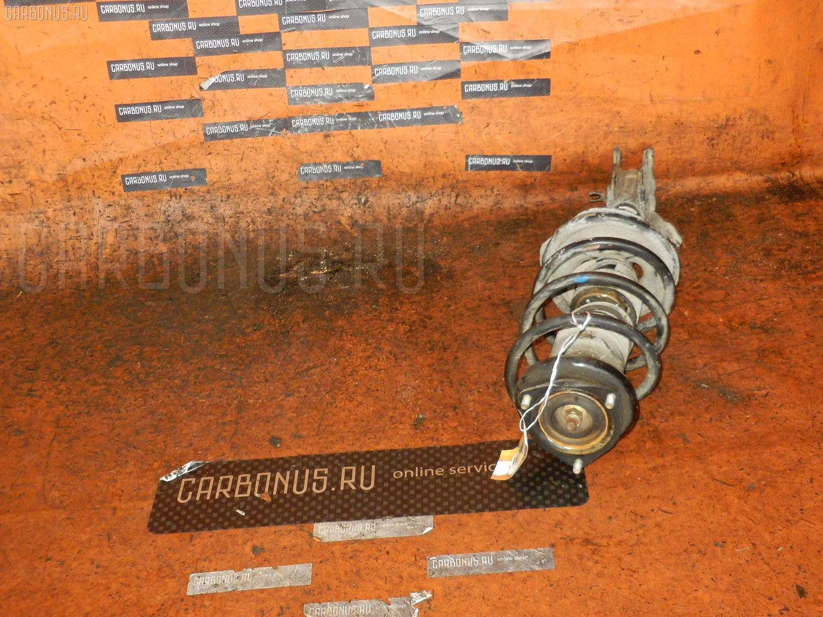 Стойка амортизатора NISSAN AD VAN VHNY11 QG18DE. Фото 1
