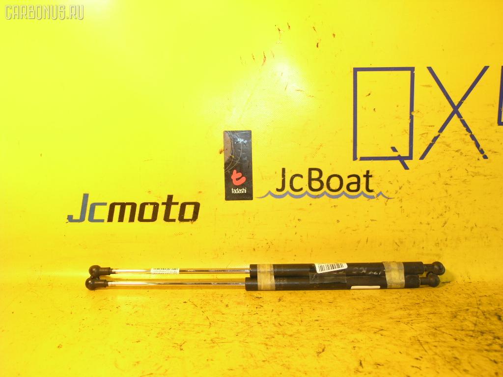 Амортизатор капота TOYOTA CRESTA GX100. Фото 3