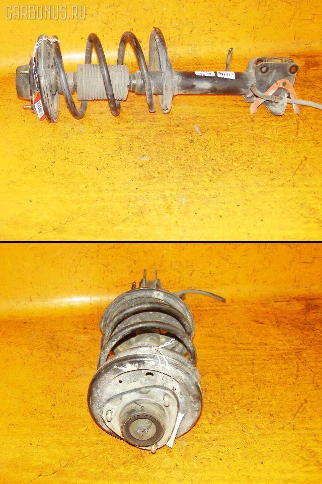 Стойка амортизатора MITSUBISHI PAJERO IO H76W 4G93. Фото 2