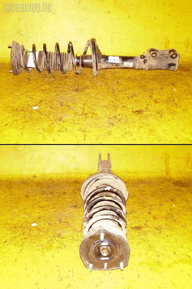 Стойка амортизатора TOYOTA CARINA AT210 4A-FE. Фото 11
