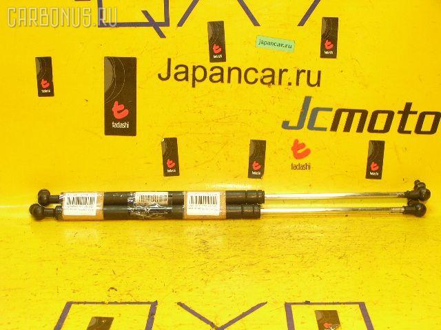 Амортизатор капота TOYOTA CROWN JZS151. Фото 3