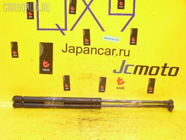 Амортизатор капота TOYOTA MARK II GX90. Фото 4