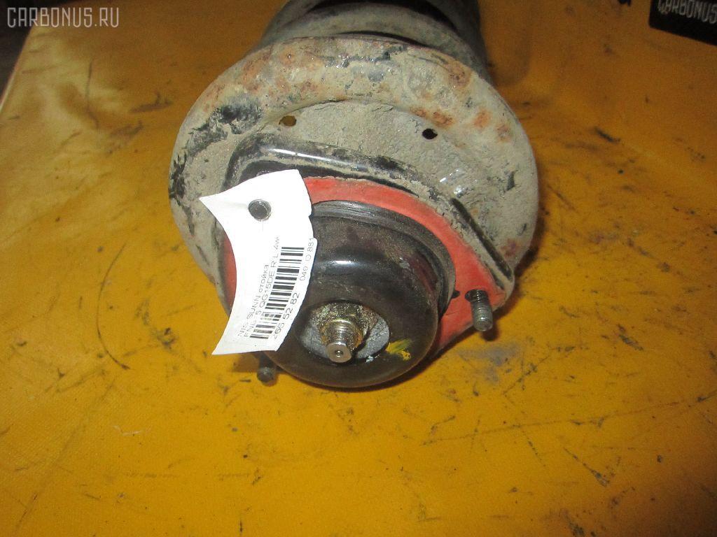 Стойка амортизатора NISSAN SUNNY FNB15 QG15DE. Фото 2