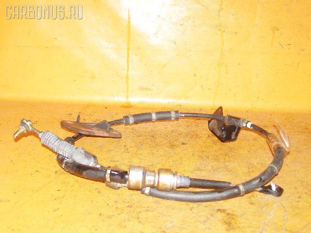 Тросик на коробку передач Nissan Bluebird sylphy TG10 QR20DD Фото 1