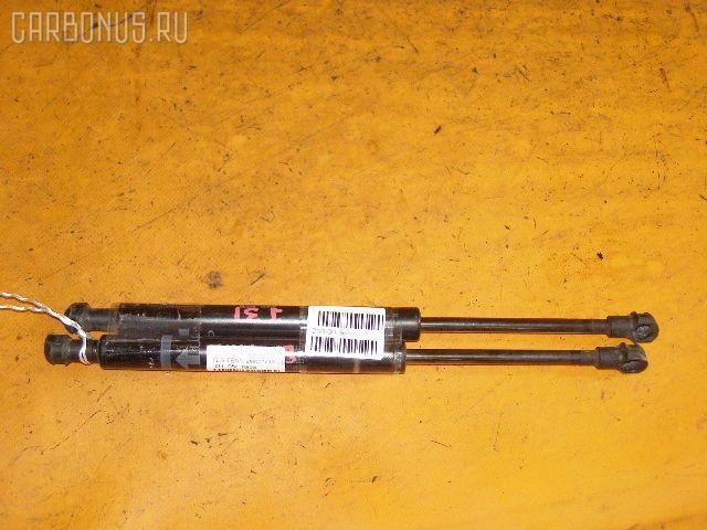Амортизатор багажника NISSAN TEANA J31. Фото 2