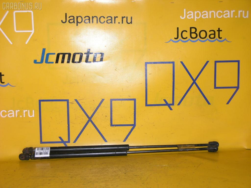 Амортизатор двери FORD MONDEO III WF0CJB. Фото 2