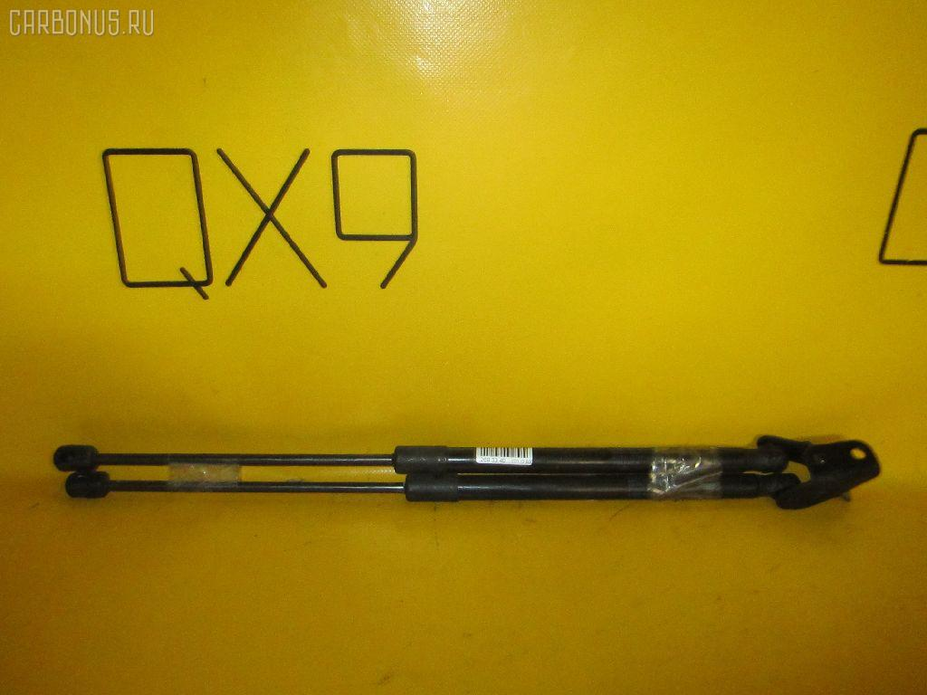 Амортизатор двери SUZUKI SWIFT ZC72S Фото 1