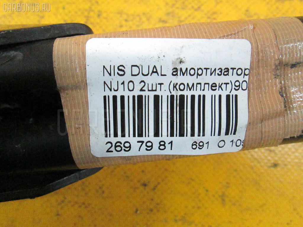Амортизатор двери NISSAN DUALIS NJ10 Фото 2