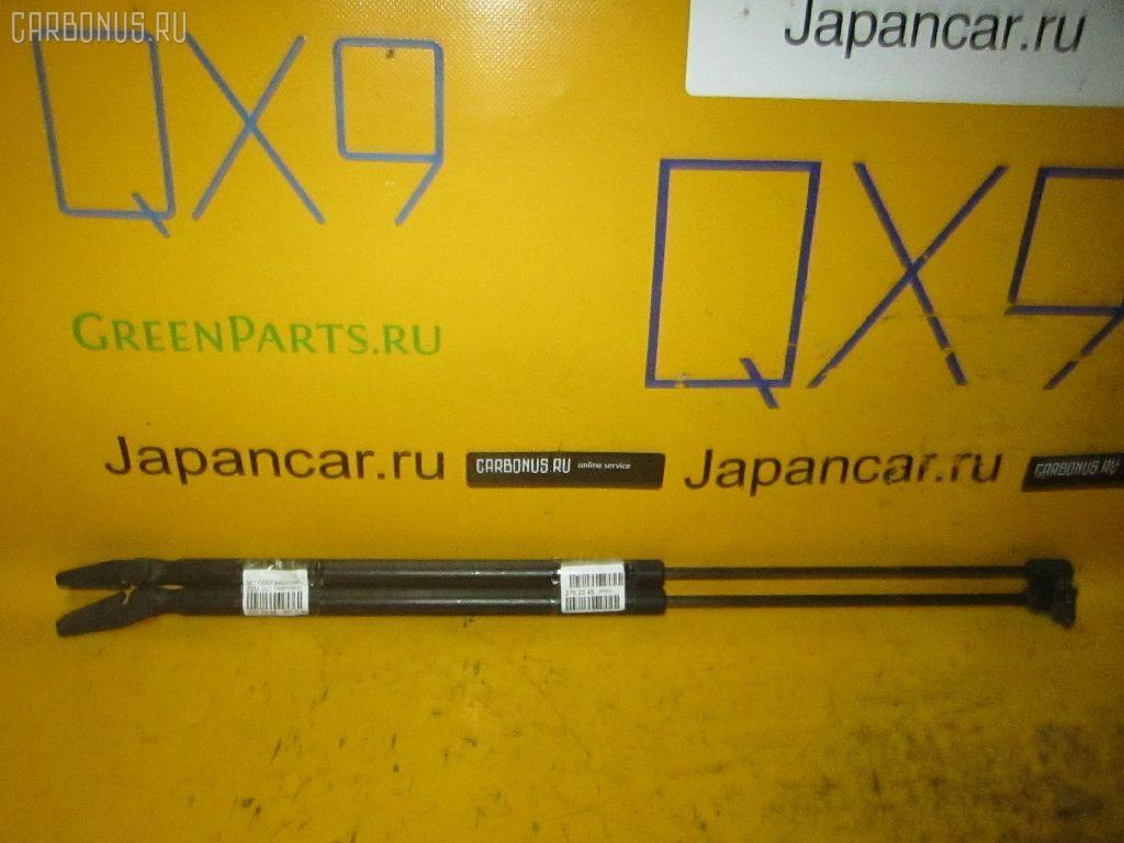 Амортизатор двери Mitsubishi Colt Z21A Фото 1