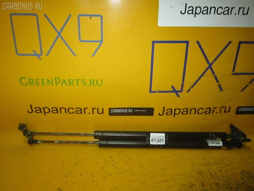 Амортизатор двери MITSUBISHI GRANDIS NA4W Фото 1