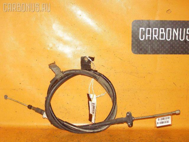 Тросик стояночного тормоза TOYOTA CARINA AT212 5A-FE. Фото 4