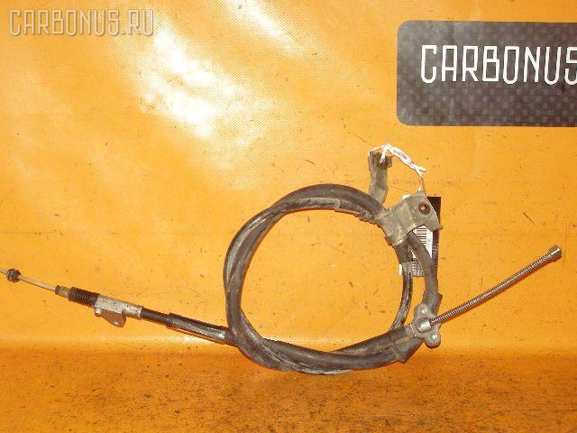Тросик стояночного тормоза TOYOTA CARINA AT212 5A-FE. Фото 5