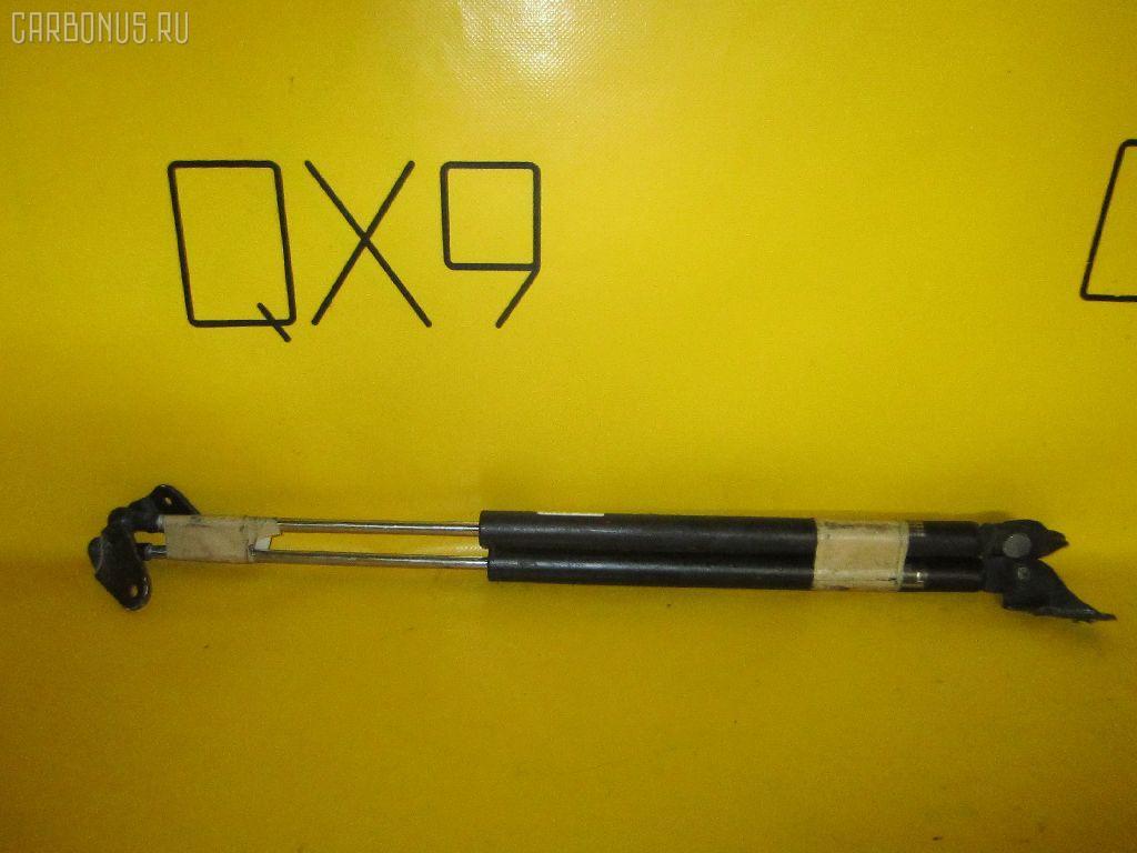 Амортизатор двери MAZDA PREMACY CREW. Фото 1
