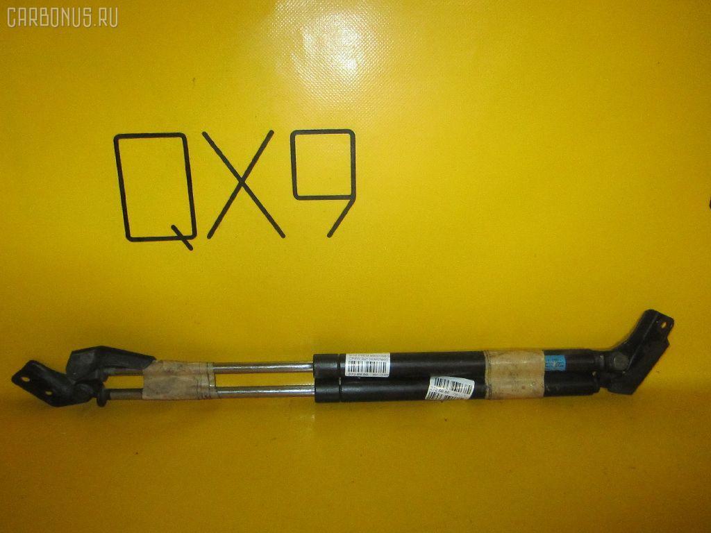 Амортизатор двери MAZDA PREMACY CP8W. Фото 7