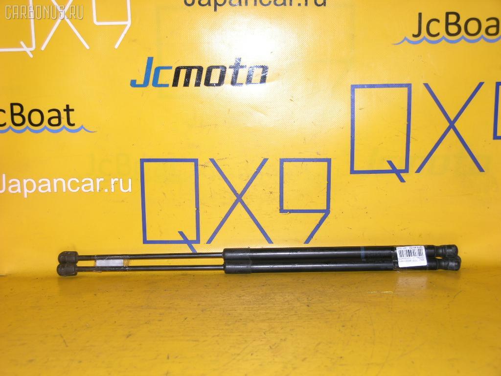 Амортизатор двери MAZDA DEMIO DY3W Фото 1