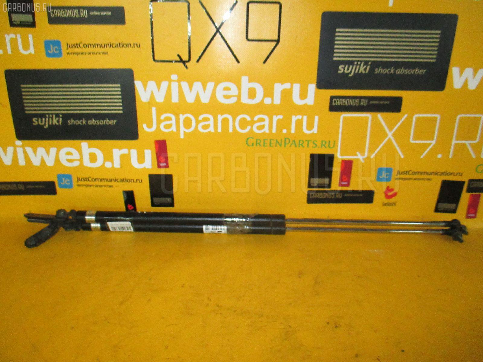 Амортизатор двери NISSAN AVENIR W11. Фото 2
