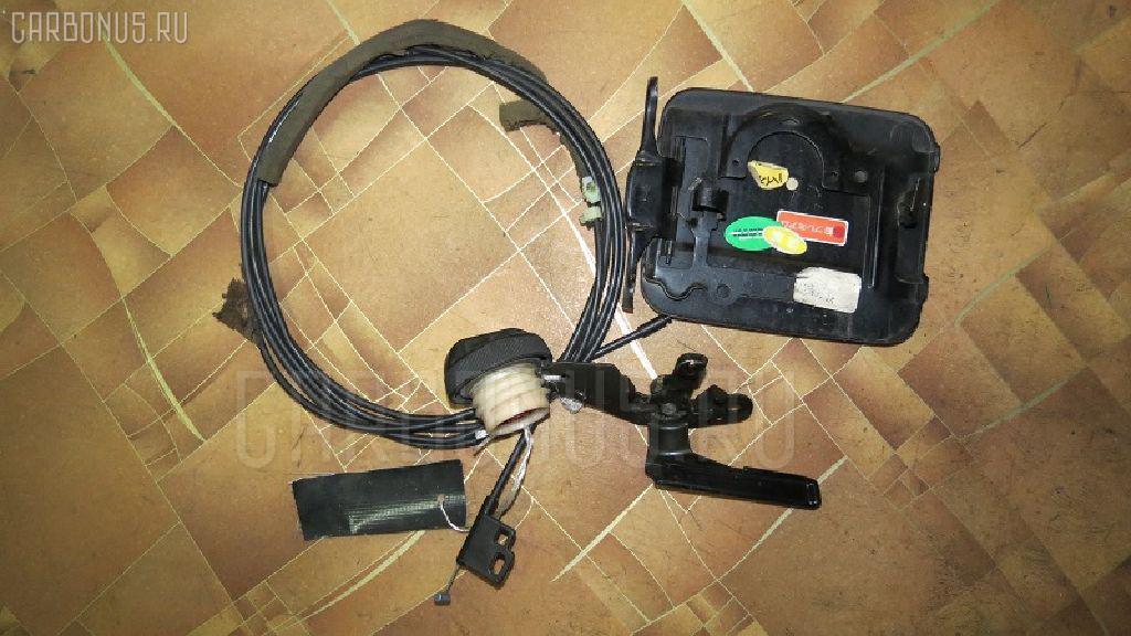 Тросик топливного бака Nissan Avenir PNW10 Фото 1