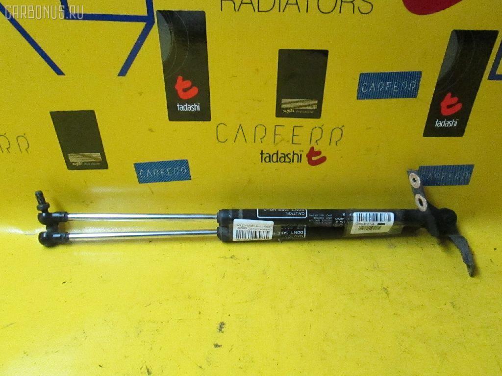 Амортизатор двери MAZDA PROCEED MARVIE UV56R Фото 1