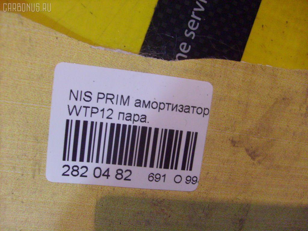 Амортизатор двери NISSAN PRIMERA WAGON WTP12 Фото 1