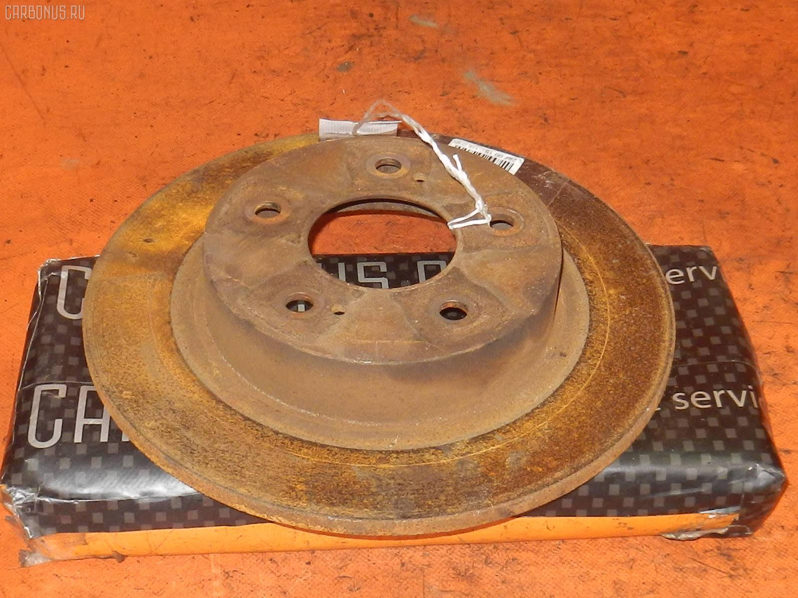 Тормозной диск NISSAN CEFIRO A32 VQ20DE. Фото 1