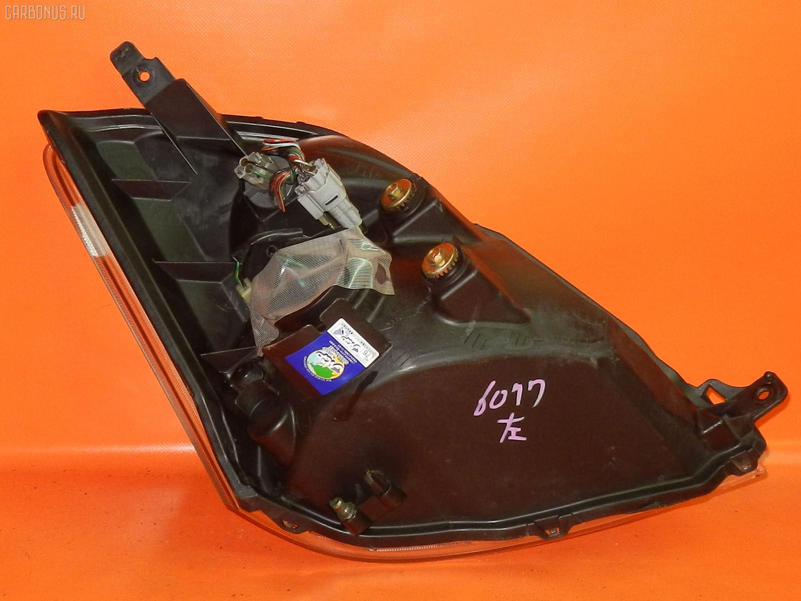 Фара NISSAN MOCO MG21S. Фото 10