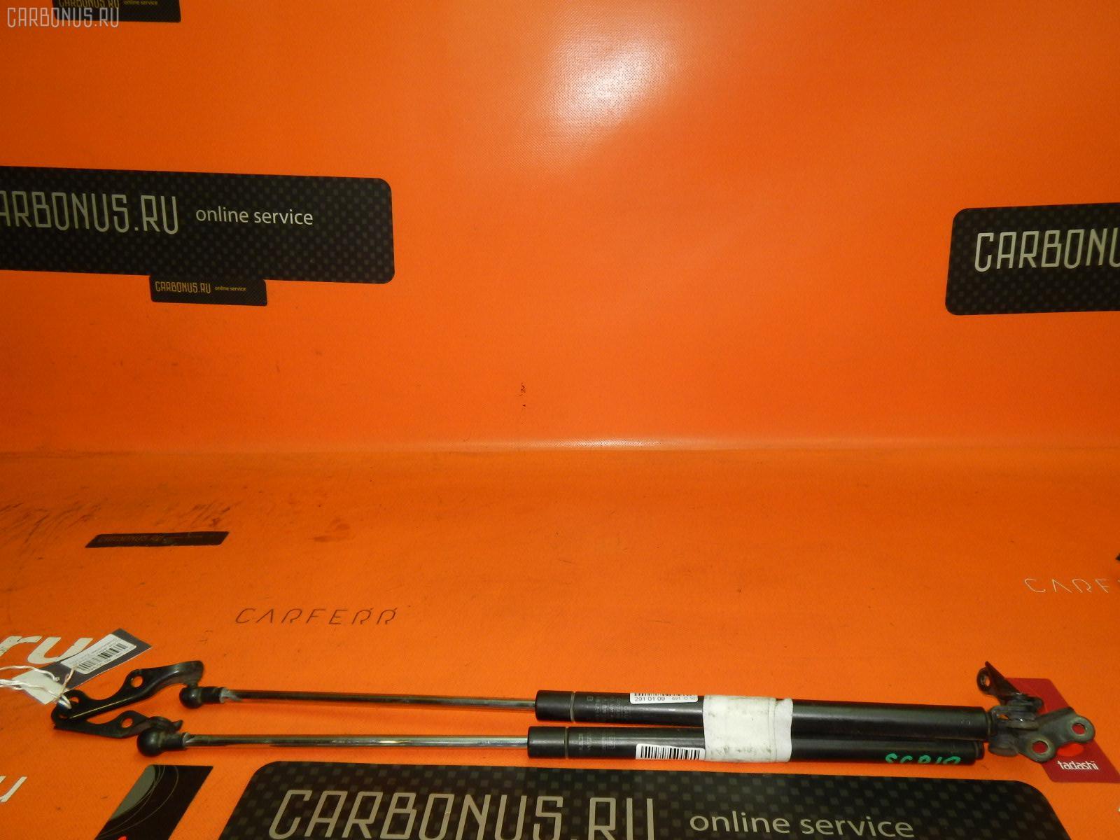 Амортизатор двери TOYOTA VITZ SCP10. Фото 4