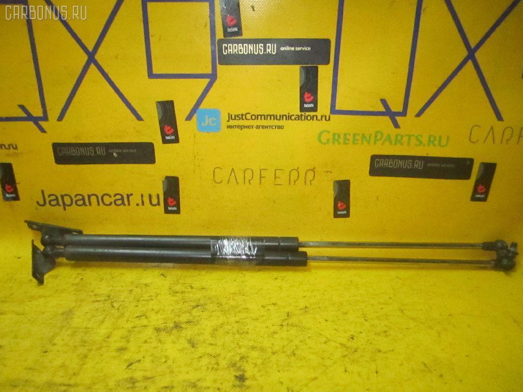 Амортизатор двери TOYOTA COROLLA SPACIO AE111N Фото 1