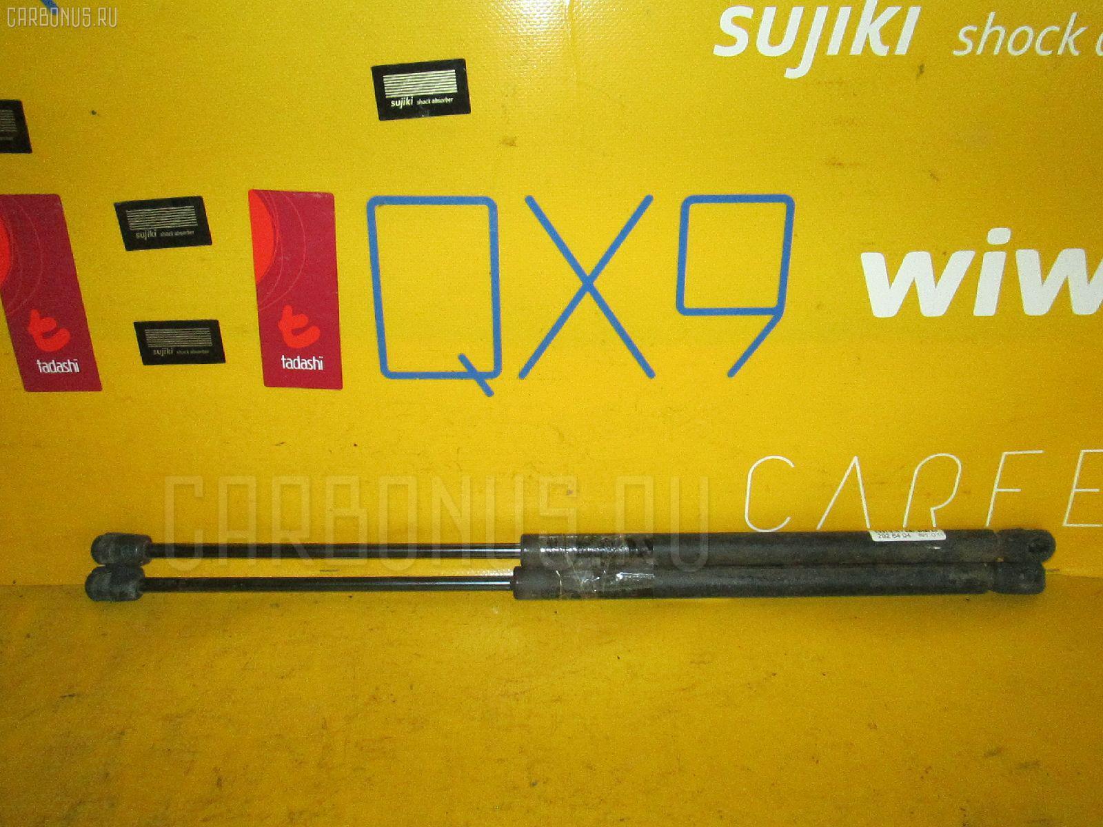 Амортизатор двери NISSAN MARCH AK12. Фото 3