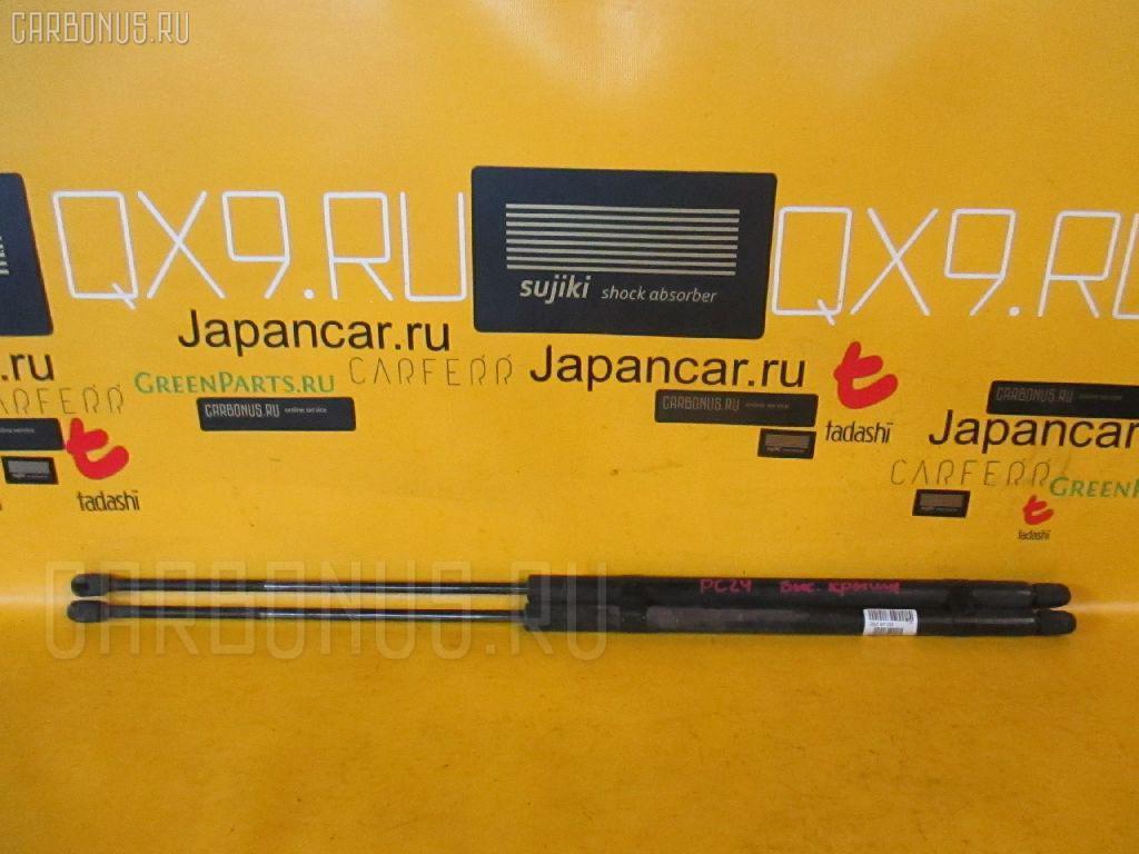 Амортизатор двери NISSAN SERENA PC24. Фото 3