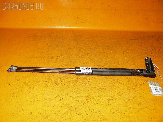 Амортизатор двери NISSAN X-TRAIL NT30. Фото 4