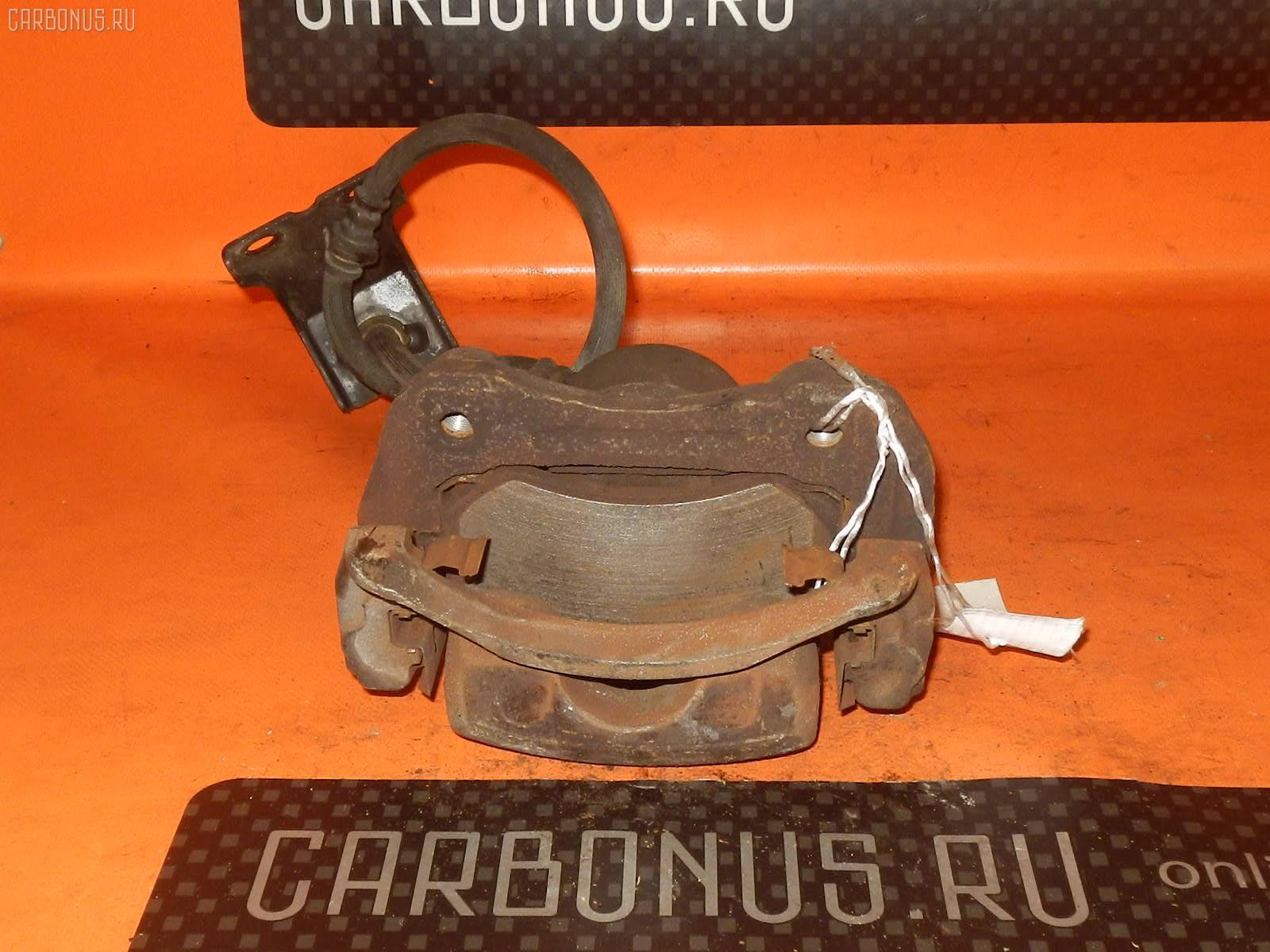 Суппорт NISSAN LAUREL HC33 RB20DE Фото 2
